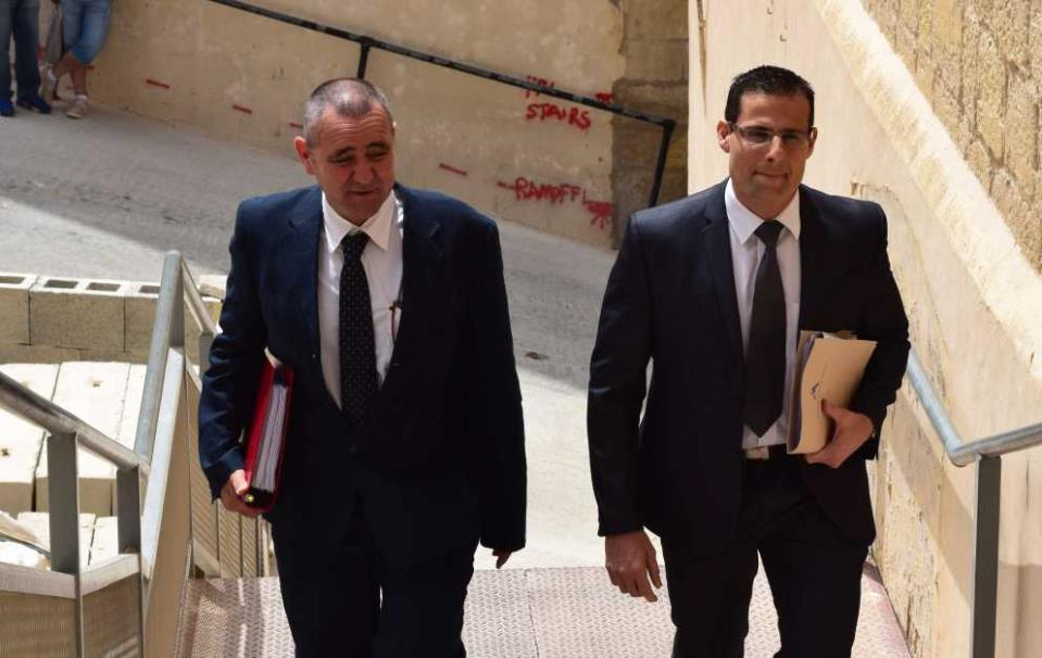 Whistleblower Joe Cauchi (left) entering the Gozo Court, accompanied by his lawyer Robert Abela
