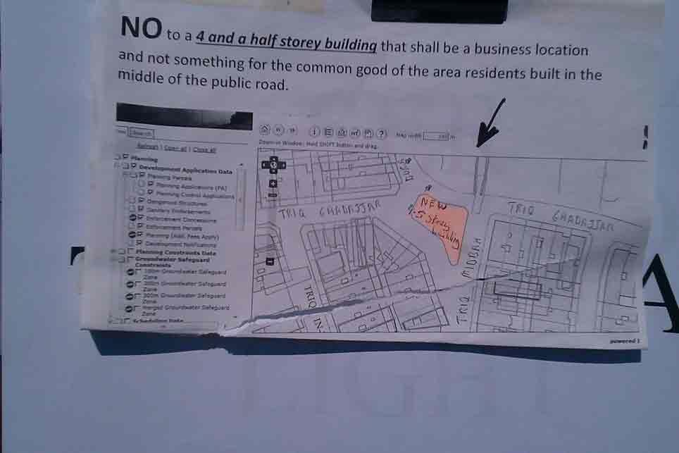 Residents rally against proposed 4-storey building in the