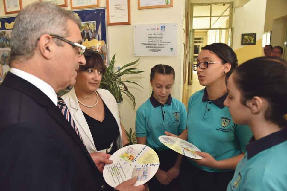 Minister Bartolo receiving the water conservation cards designed by students of St Thomas More Middle School Tarxien