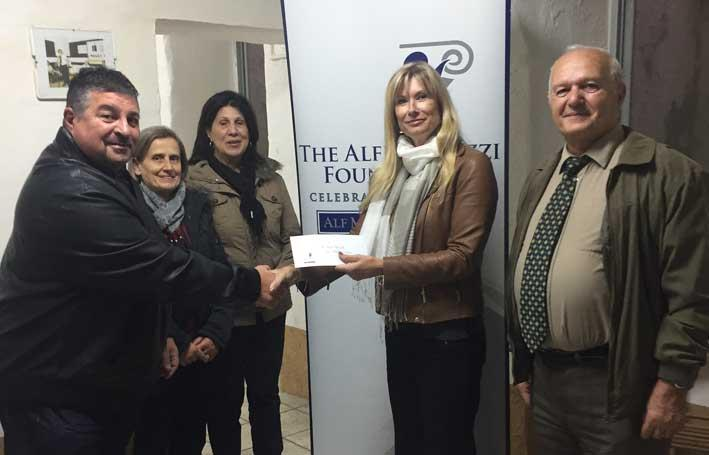 Jane Mizzi presenting Mark Vella with The Alfred Mizzi Foundation's contribution