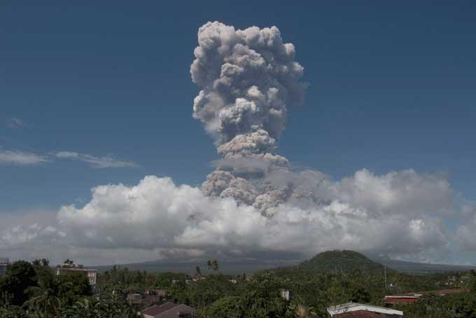A huge column of ash shoots up to the sky during the eruption of Mayon volcano Monday, Jan. 22, 2018 as seen from Legazpi city, Albay province, around 340 kilometers (200 miles) southeast of Manila, Philippines.