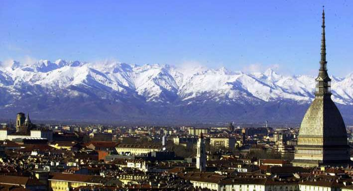 A view of Turin, Italy, with the main city landmark, the Mole Antonelliana, at right, and the Alps in background are seen in this December 2005 photo. Milan and Turin are in discussions with the Italian Olympic Committee over a possible bid for the 2026 Winter Games. Turin Mayor Chiara Appendino sent a letter of interest to CONI on Sunday despite divisions in her own party, the populist 5-Star Movement, on a candidacy. (AP Photo/Massimo Pinca)