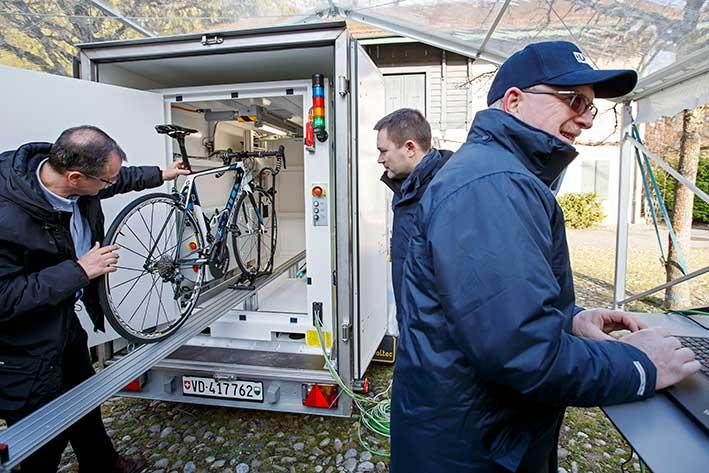 A technician puts a bicycle into the X-Ray machine in front of the UCI President David Lappartient, 2nd left, during a UCI's press conference about Fight against technological fraud, in Geneva, Switzerland, Wednesday, March 21, 2018. (Salvatore Di Nolfi/Keystone via AP)