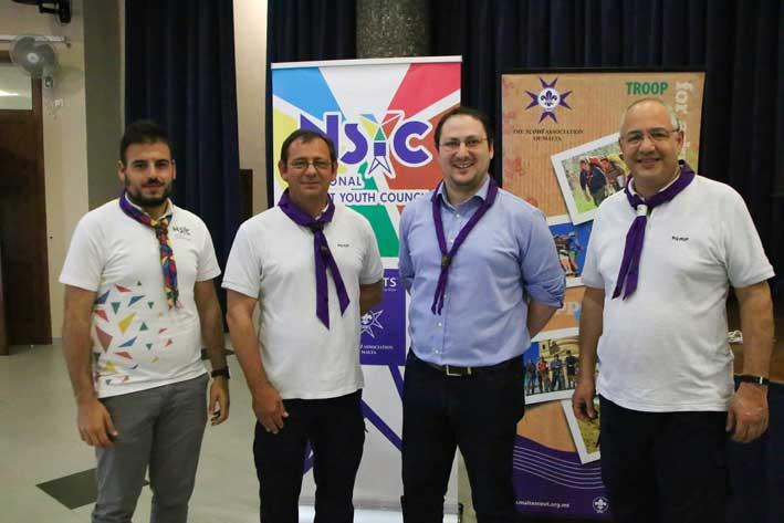 Sean Bartolo - NSYC Chair; Leslie Bonnici - outgoing chief commissioner; Anton Pisani - chief commissioner and George Cassar - Chief scout