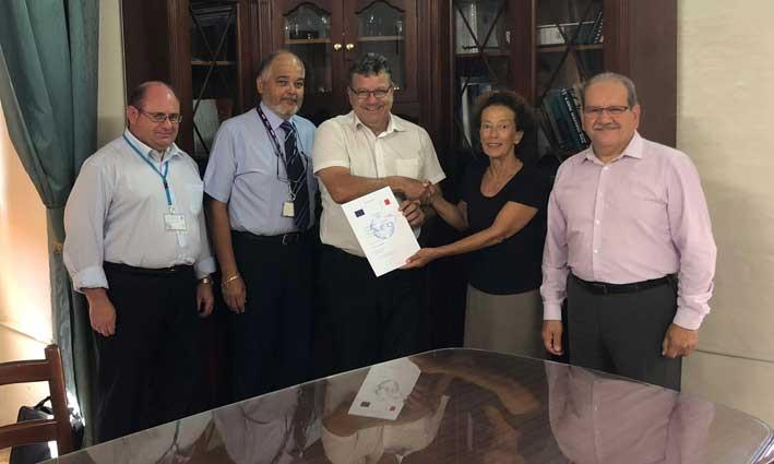 Diana Cassar, Managing Director of C&C Express Ltd receiving the AEOF certification from Joseph Chetcuti, Director General at Customs in the presence of Francis Callus, Inspector of Customs and AEO Contact Point, John Azzopardi, QA Manager at C&C Express and Paul Bonello, Advisor Customs Procedures & AEO Programme.