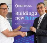 George Debono, Chief Commercial Officer at BNF Bank with Martin Xuereb, Chairperson of RMHC Malta