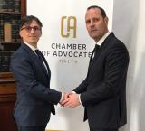 Dr Malcolm Mallia from LEXCO with Dr Stefan Camilleri, Secretary General of the Chamber of Advocates following the agreement signing.