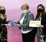 Minister for Education Justyne Caruana presenting the Training at Work award to Ms Antoinette Caruana, Group HR Manager and Company Secretary, Simonds Farsons Cisk plc (centre) and Ms Mariella Galea, L & D and Performance Manager, Simonds Farsons Cisk plc.
