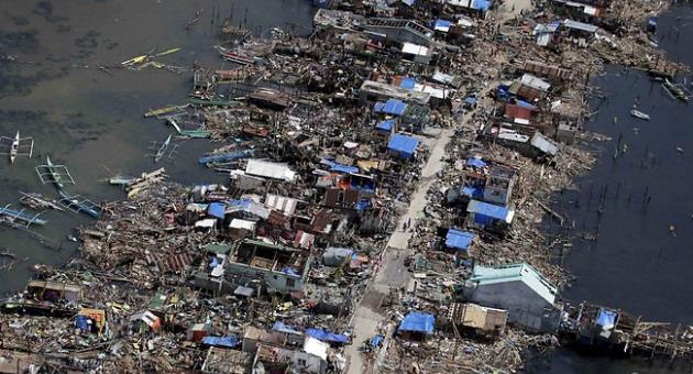 philippines typhoon weakens to storm at least 21 dead. Black Bedroom Furniture Sets. Home Design Ideas